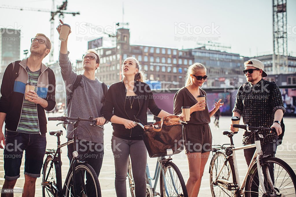 Exploring foreign city on bike stock photo