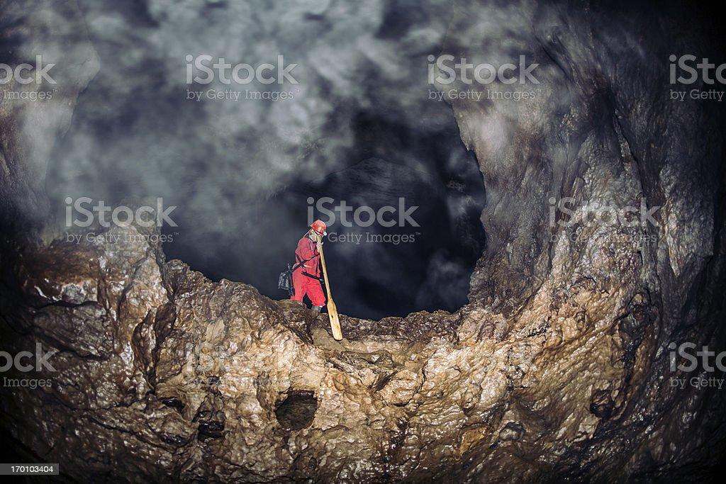Exploring misty caves deep underground stock photo