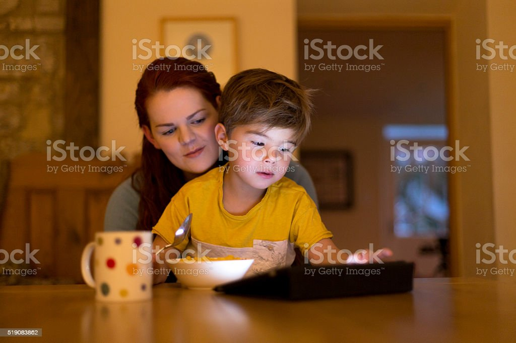 Exploring online with mum. stock photo