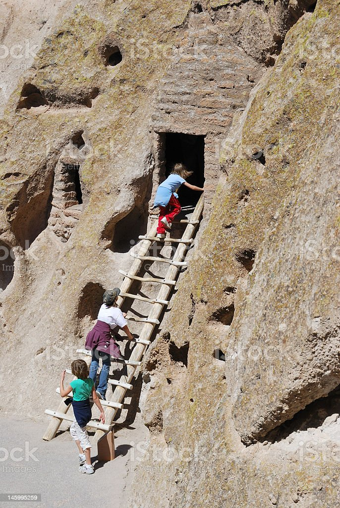 Exploring ruins at Bandelier National Monument stock photo