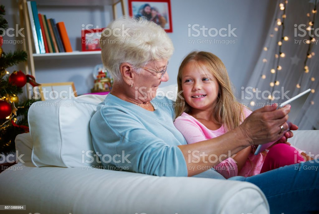 Exploring the online world with grandmother stock photo