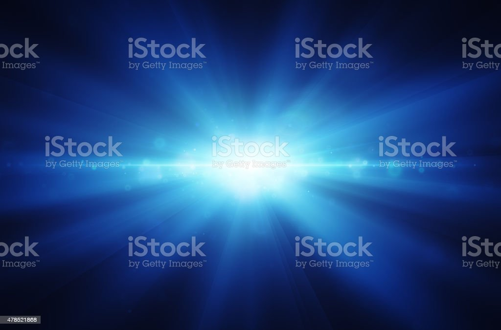 explosion of blue luminous rays stock photo