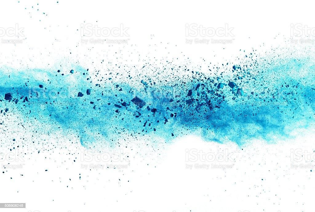 Explosion of blue powder on white background stock photo
