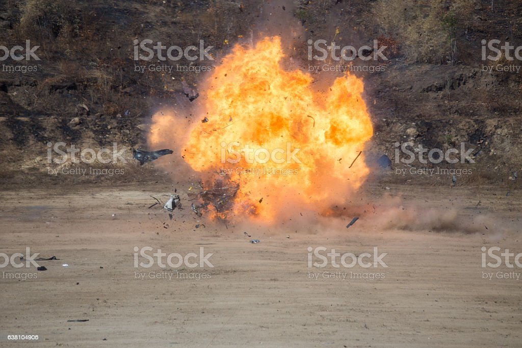 explosion of car part blown away from car bomb training stock photo