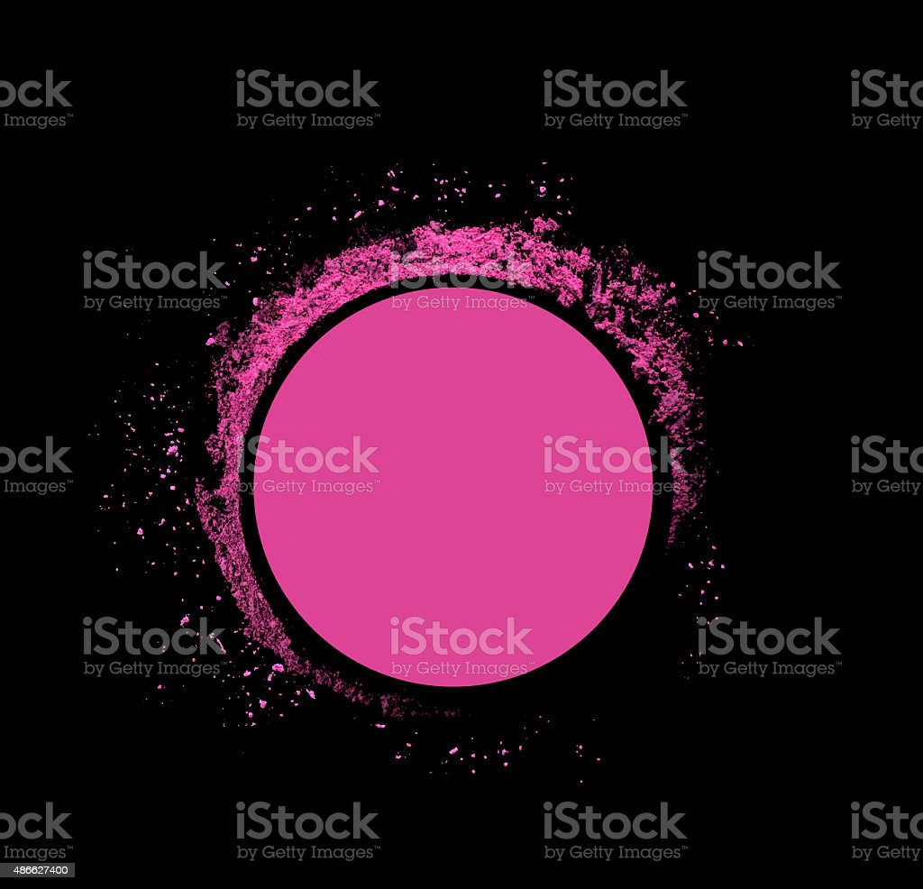 Explosion suspension of pink powder makeup isolated on black background stock photo
