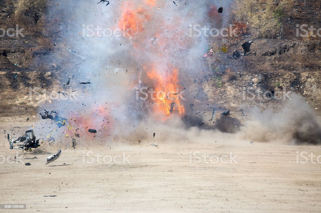 explosiont of car part blown away from car bomb training stock photo