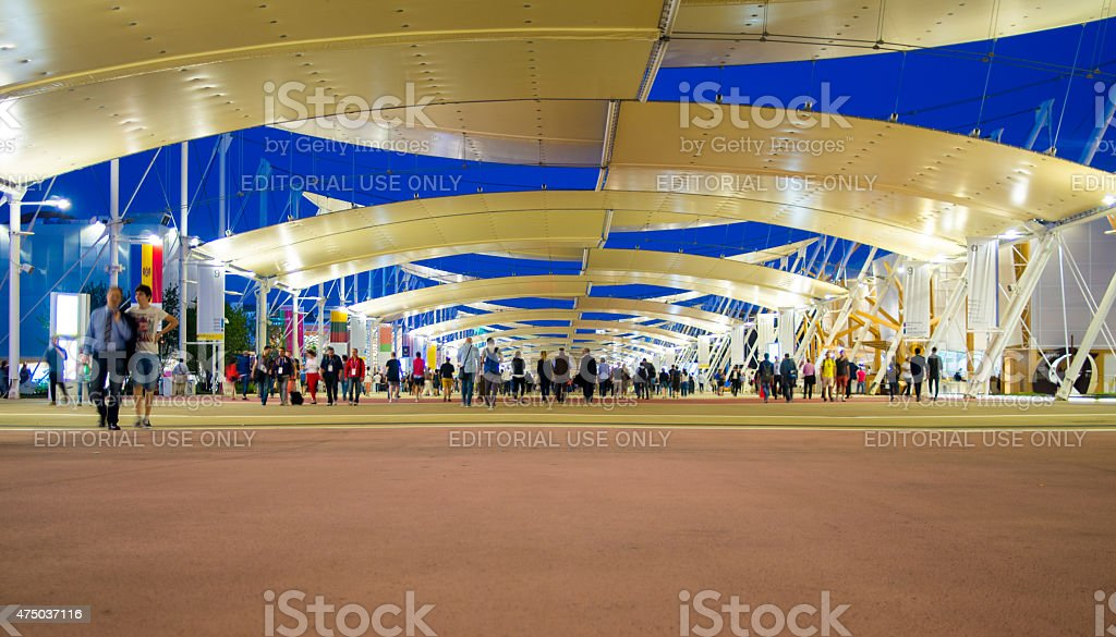 Expo 2015, People walking on the Decumano street at night stock photo