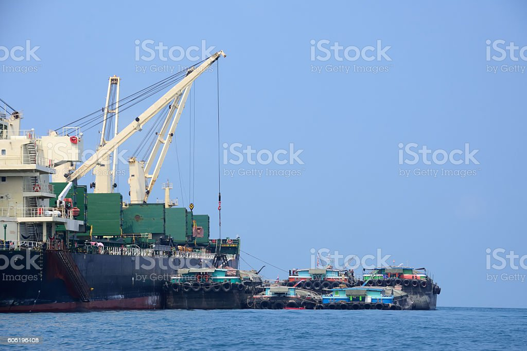 Export transportation ship in the harbor stock photo