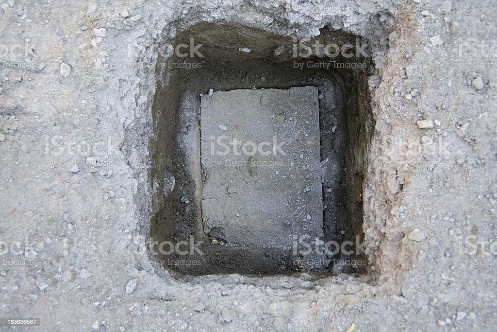 Exposed septic tank lid stock photo