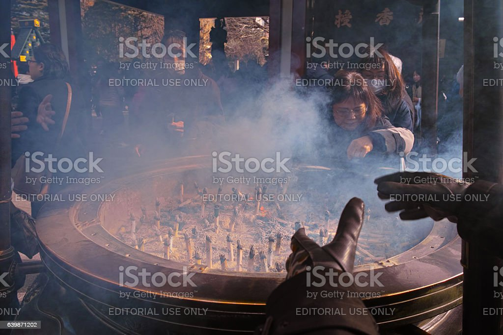 Exposed to the smoke of incense stock photo