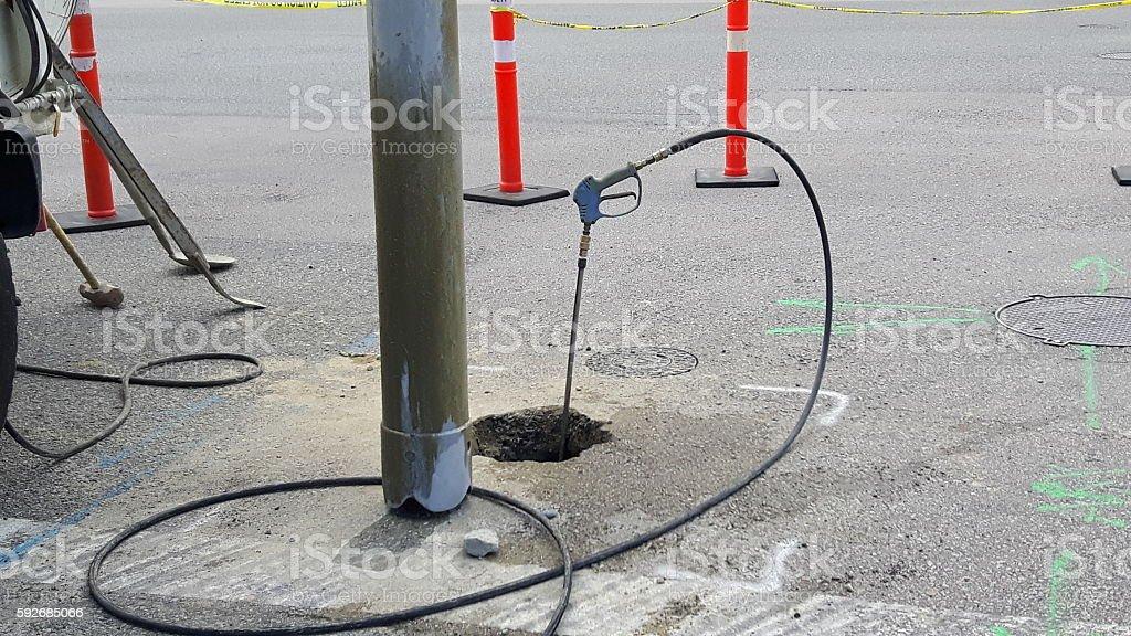 Exposing underground utility pipes stock photo