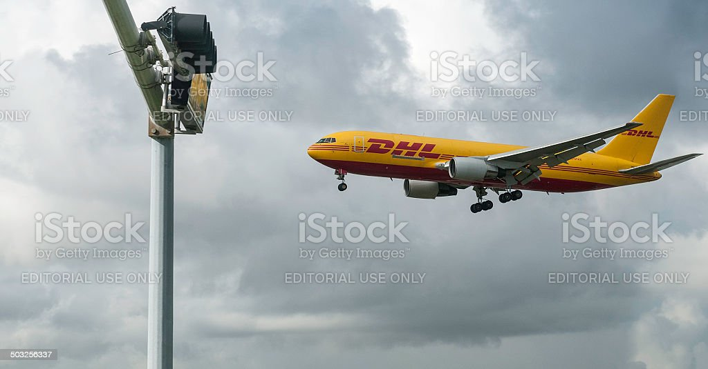DHL Express arriving on time royalty-free stock photo