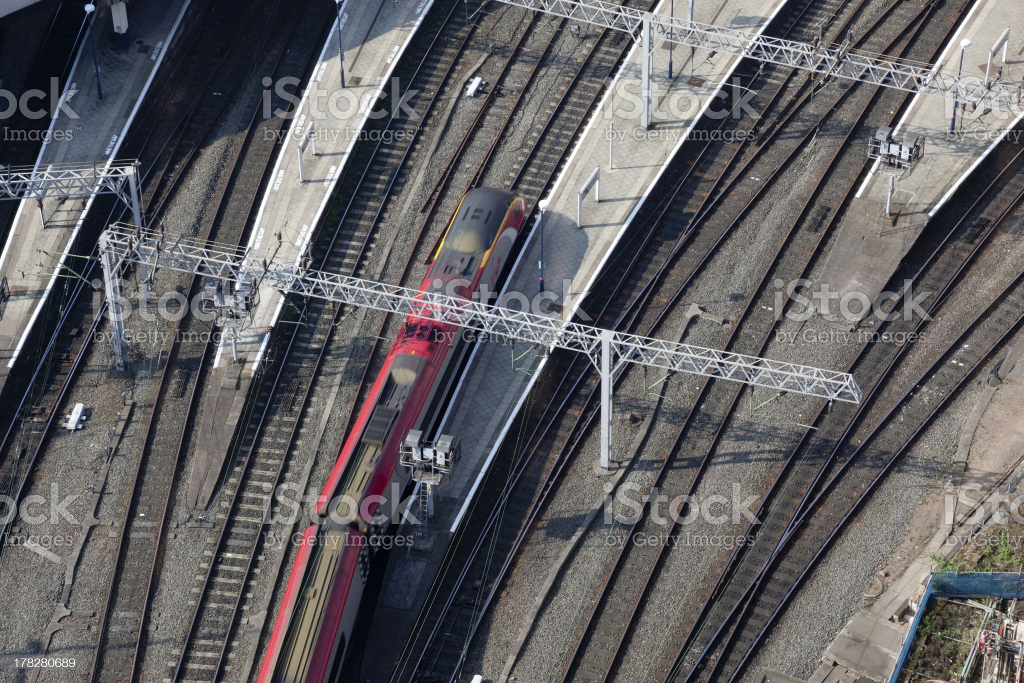 Express train arriving at a station royalty-free stock photo