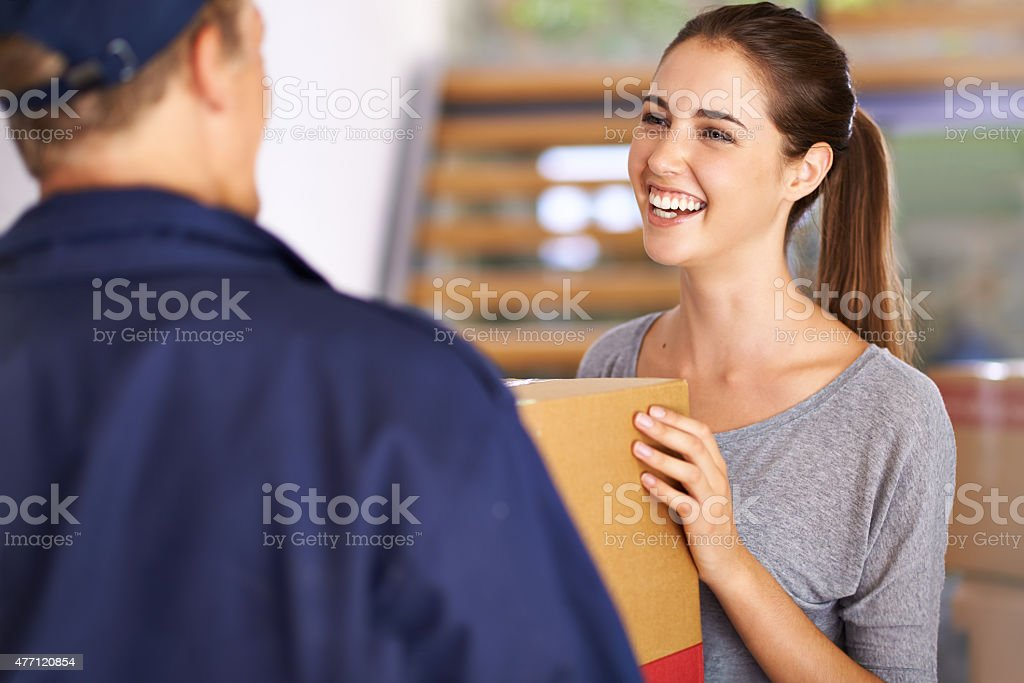 Expressing delight at receiving her express delivery stock photo