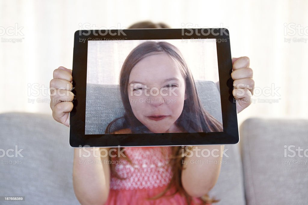 Expressing herself with her new tablet! stock photo