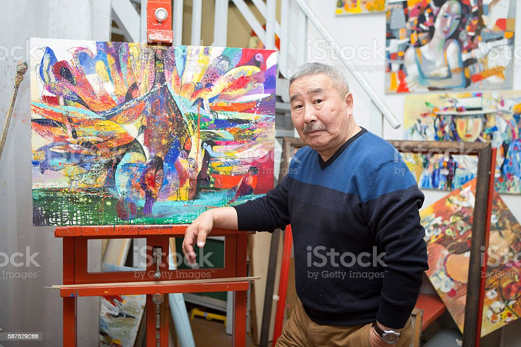 Expressionist artist in his art studio stock photo