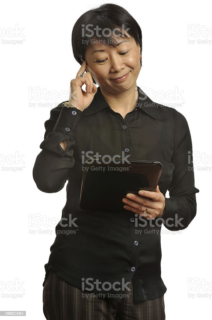 Expressive Asian executive working with tablet computer royalty-free stock photo