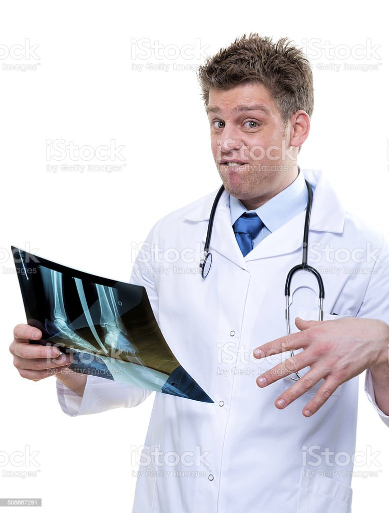 expressive doctor examining broken foot x-ray royalty-free stock photo