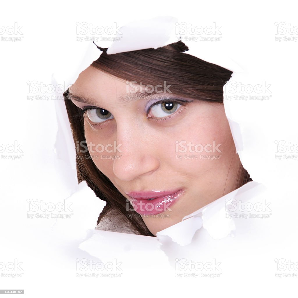 expressive faces of the emotional person in a paper hole stock photo