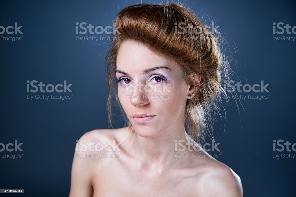 Expressive fashion portrait of young beautiful woman on dark background royalty-free stock photo