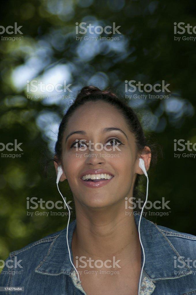 Expressive Girl Listening To Headphones royalty-free stock photo