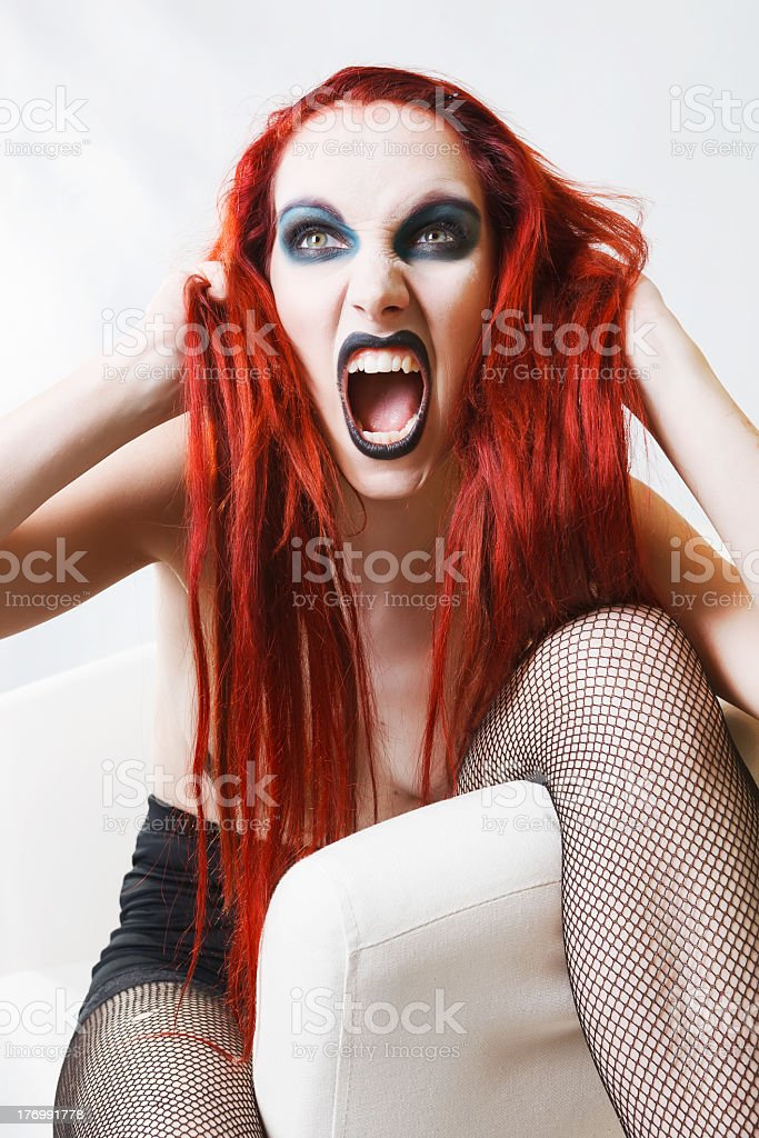 Expressive gothic woman with artistic makeup royalty-free stock photo