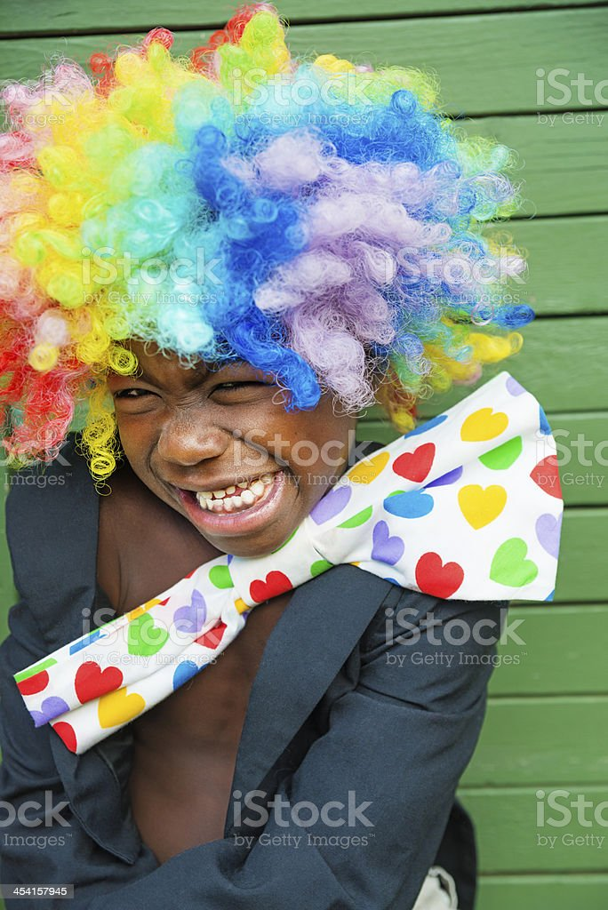 Expressive little black boy with a clown costume. royalty-free stock photo