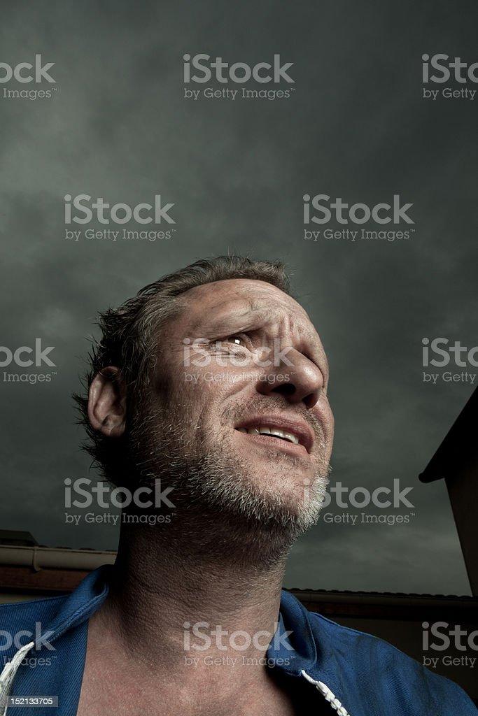 expressive man doing a stress face stock photo