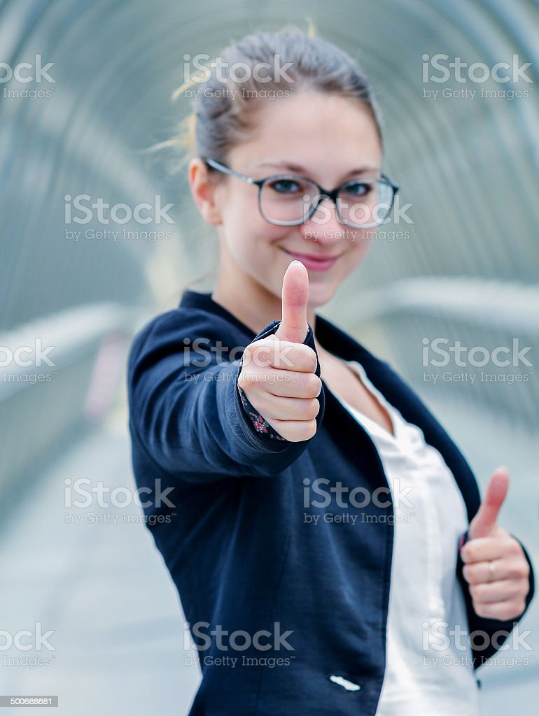 expressive portrait of junior executive of company thumb up royalty-free stock photo