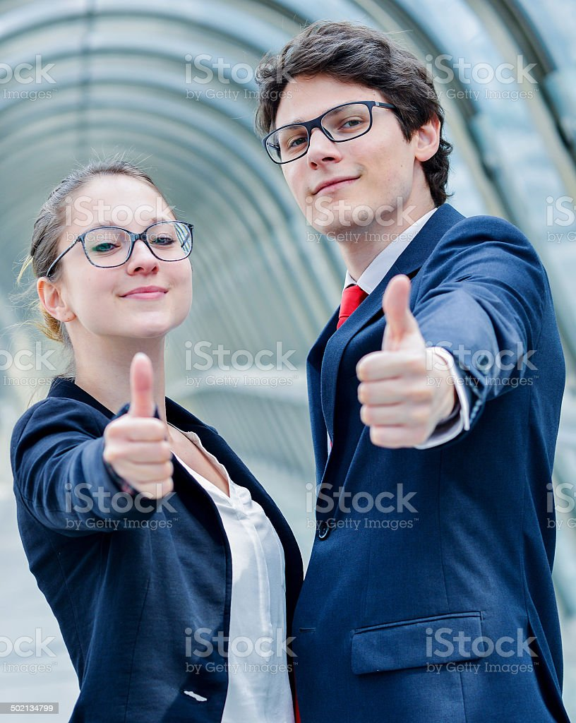 expressive portrait of junior executives of company thumb up royalty-free stock photo