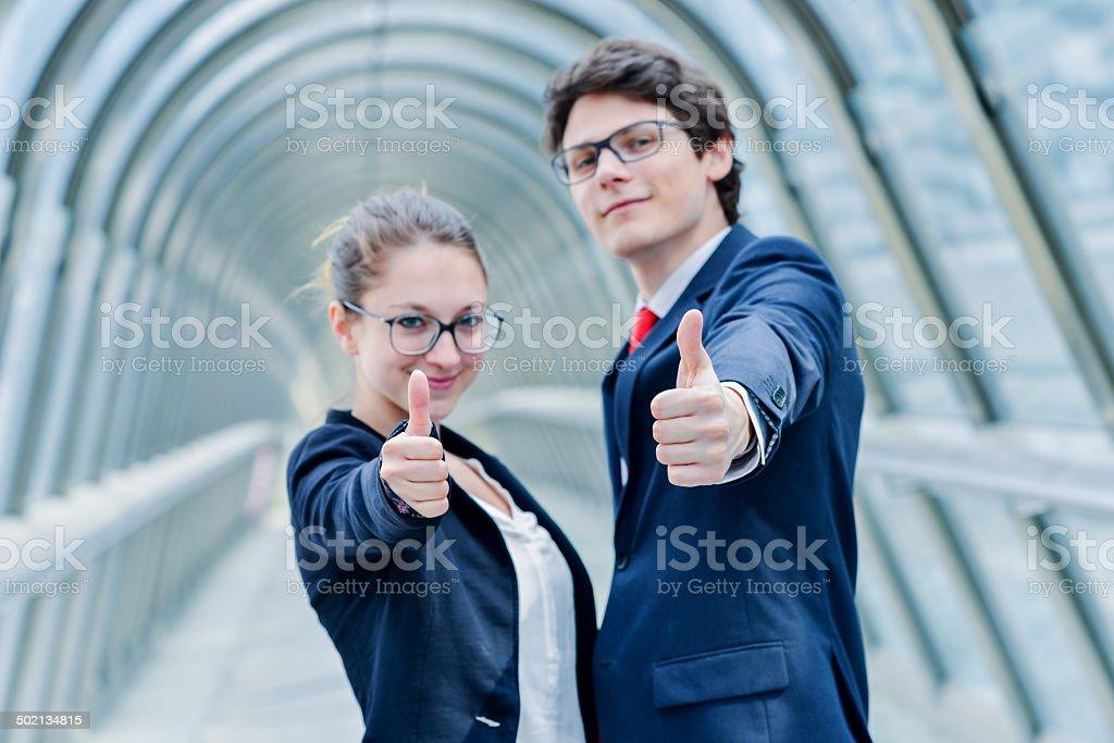expressive portrait of junior executives of company thumb up royalty-free stock photo
