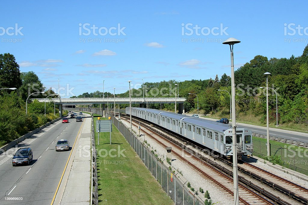 expressway and commuter train royalty-free stock photo