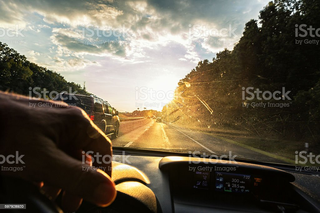 Expressway Bridge Driving POV Sunset Through Speeding Car Windshield stock photo