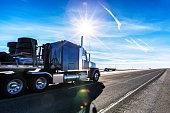 Expressway Flatbed Semi Trailer Trucks on Western USA Sunflare Highway