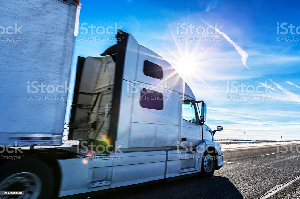 Expressway Semi Trailer Truck on Western USA Sunflare Highway stock photo