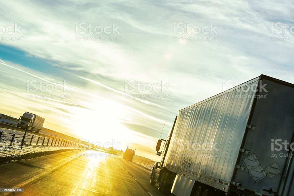 Expressway Semi Trailer Trucks on Western Sunset USA Highway stock photo