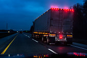 Expressway Speeding Car Driver POV Passing Illuminated Semi Trailer Truck