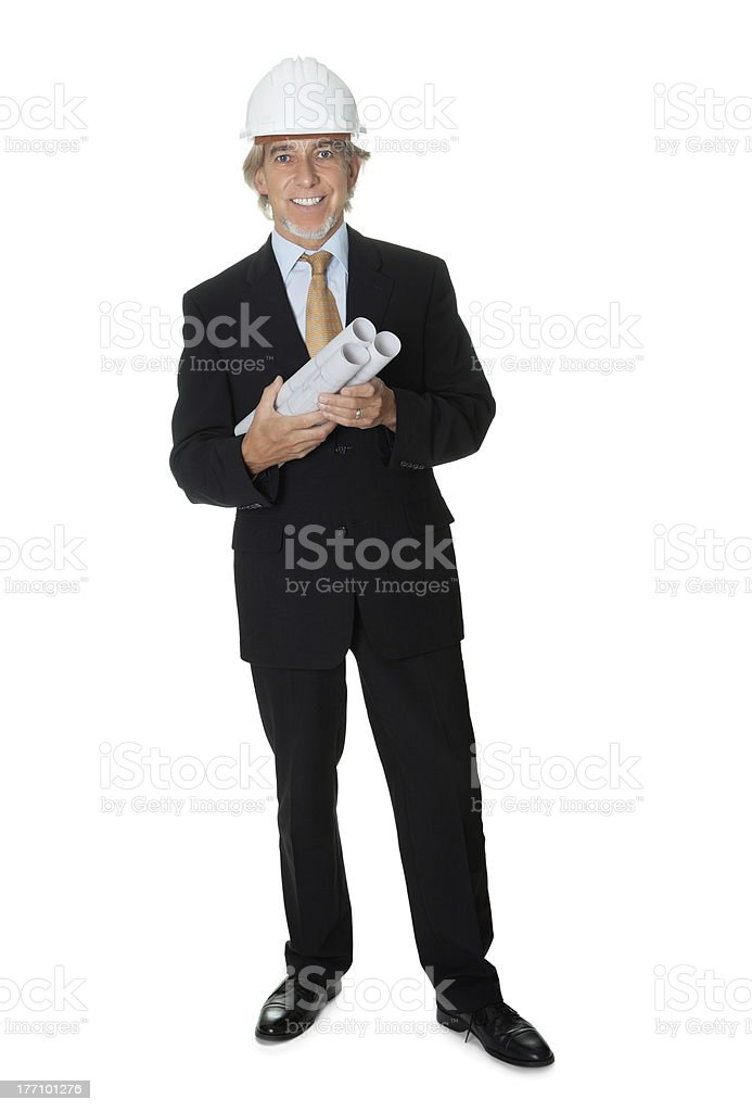 Exprienced engineer holding some building plans royalty-free stock photo