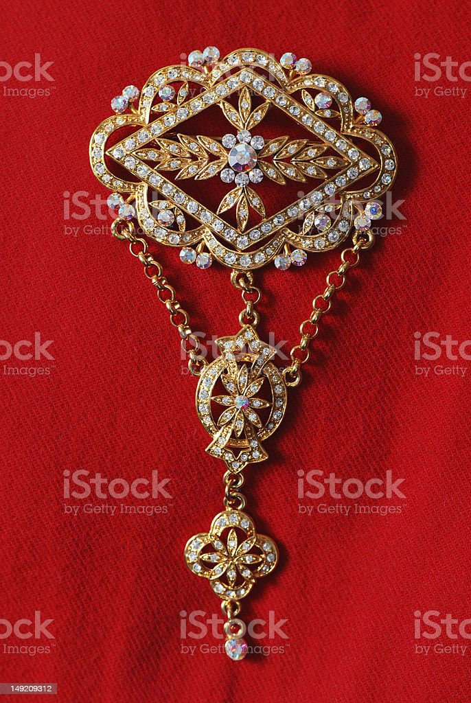 Exquisite gold brooch adorned with gems royalty-free stock photo