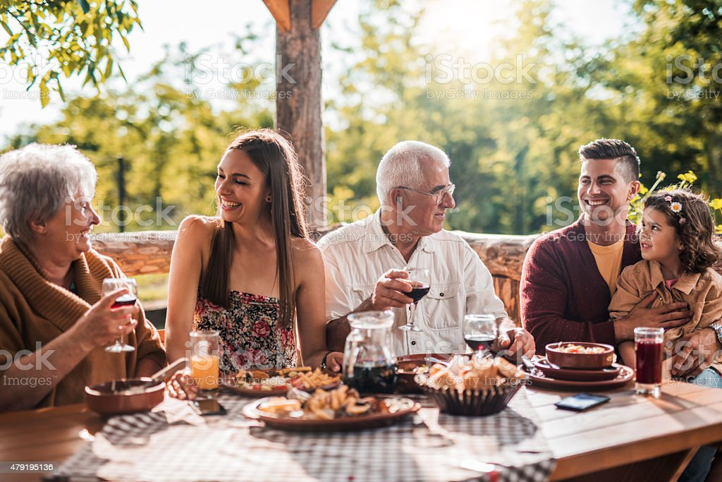 Extended family communicating on lunch in a restaurant. stock photo