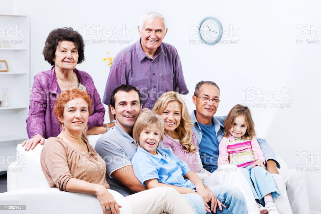 Extended family enjoying at home stock photo