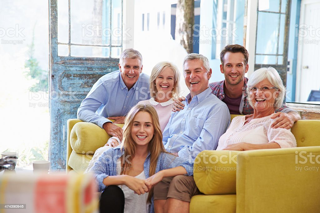 Extended Family Group At Home Relaxing In Lounge stock photo