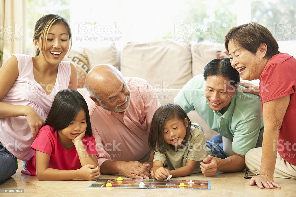 Extended Family Group Playing Board Game At Home stock photo