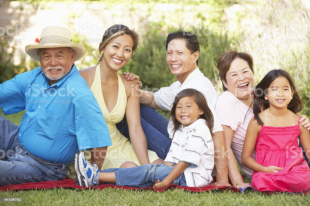 Extended Family Group Relaxing In Garden royalty-free stock photo