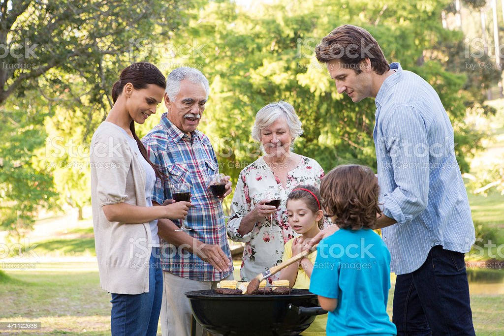 Extended family having a barbecue stock photo