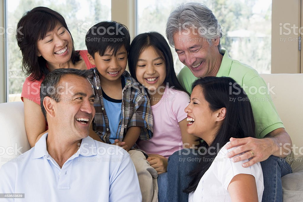 Extended family in living room stock photo