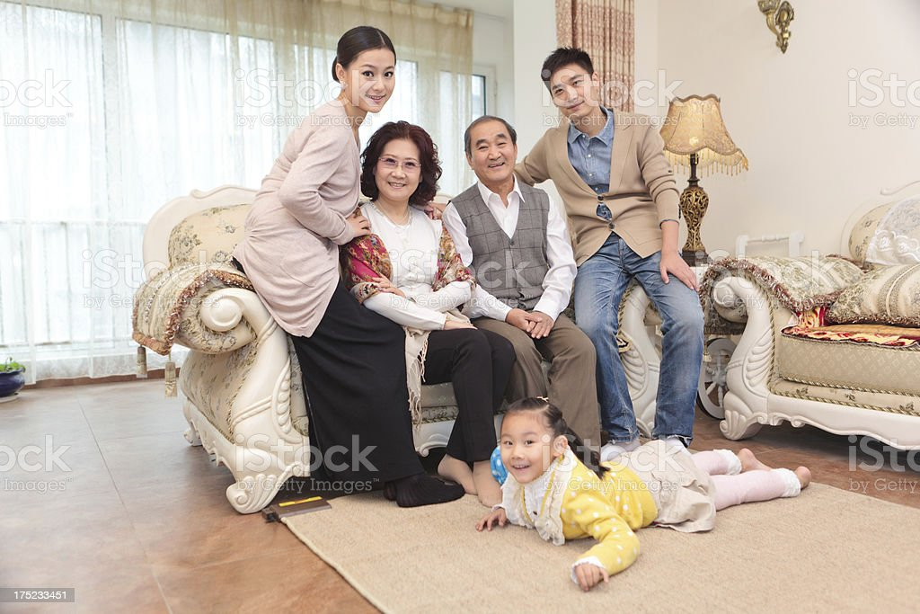 Extended family in living room smiling royalty-free stock photo