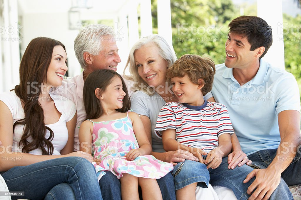 Extended family sitting in Garden royalty-free stock photo