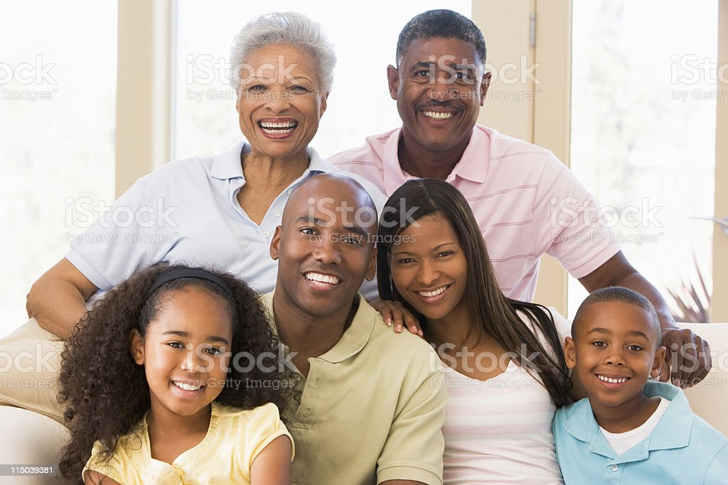 Extended family sitting on sofa royalty-free stock photo