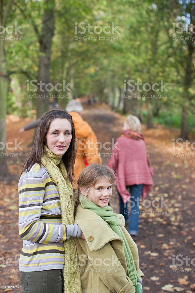 Extended family walking outdoors in autumn stock photo